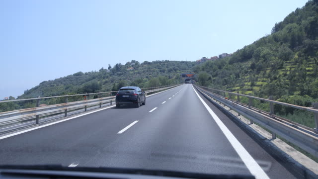 shaky camera drive with a van through tunnels in italy at the coast at the ligurian sea, the drive into the tunnel and out of the tunnel can be seen. - shaky camera stock videos & royalty-free footage
