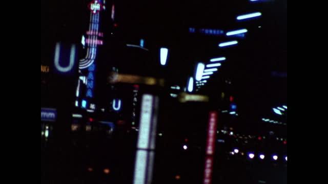 shaky car pov driving on kurfurstendamm at night in west berlin; 1969 - shaky stock videos & royalty-free footage