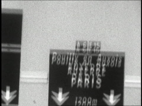 Shaky car point of view on French highway toward close up road sign