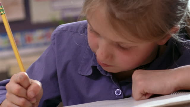 shaky close up girl writing with head down/ girl looking at camera and smiling/ goram, maine - 人間の舌点の映像素材/bロール