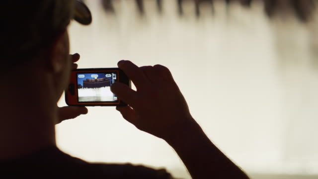 Shaky close up of person video taping fountain / Las Vegas, Nevada, United States,