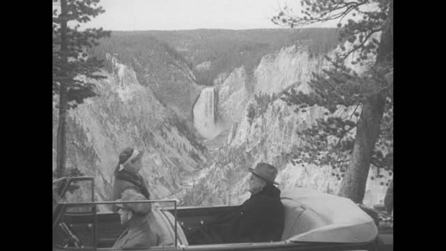 [shaky footage] president franklin d. roosevelt and first lady eleanor roosevelt viewing waterfall as they sit in car at artist point, yellowstone... - wyoming stock videos & royalty-free footage