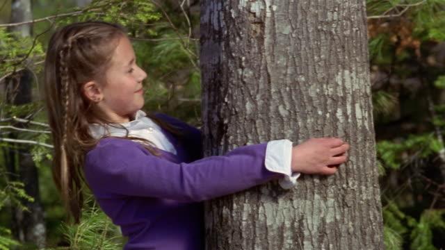 Shaky medium shot girl hugging tree/ Goram, Maine