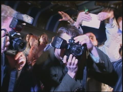 Shaky medium shot groupies shouting / photographers shooting / AUDIO