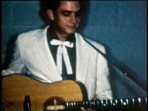 1955 shaky medium shot johnny cash in white jacket and bow tie w/guitar / levitt texas - early rock & roll stock videos and b-roll footage