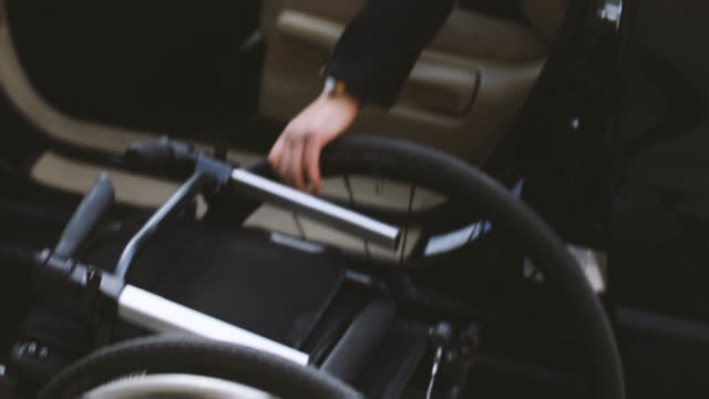 shaky shot of disabled woman in car disassembling wheelchair - knob stock videos and b-roll footage