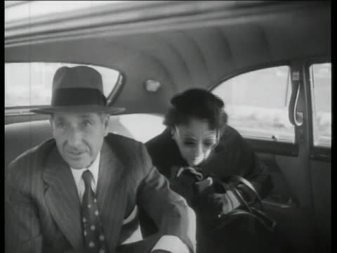 shaky shot of frank costello talking to a man who is barely visible in the frame. costello is wearing a suit and hat. cut to shot of costello's car... - shaky camera stock videos & royalty-free footage