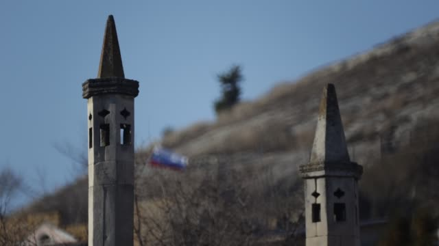 shaky shot of two minarets in foreground, barbed wire and ukrainian flag in background - symbol stock videos & royalty-free footage