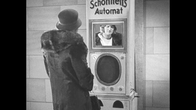 ach himmel what next slot machine makes frauleins beautiful girls in berlin germany now have automat to help fair sex grow fairer / woman stepping up... - mirror stock videos & royalty-free footage