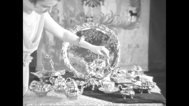 """[shaky video throughout] title card: """"czar's famous crown jewels - first pictures of the great hammer collection in new york showing some rare gems... - pitcher jug stock videos & royalty-free footage"""