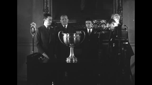 rockne team gets highest grid prize new york mayor walker presents erskine championship trophy to quarterback carideo / standing behind trophy on... - card table stock videos and b-roll footage