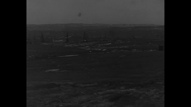 """[shaky video throughout] title card: """"tea pot, wyo. the center of a national political drama--first views of teapot dome, famous naval oil reserve... - 不祥事点の映像素材/bロール"""