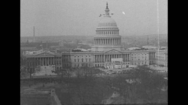 [shaky video throughout] us capitol / large crowd of spectators, with cameraman in front / sot franklin d. roosevelt takes the oath of office,... - u.s. supreme court stock videos & royalty-free footage