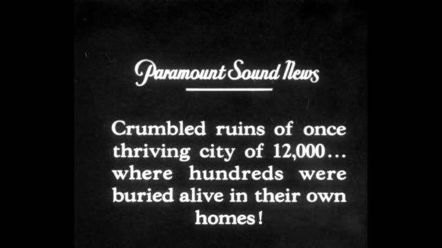 """stockvideo's en b-roll-footage met [shaky video] title card: """"crumbled ruins of once thriving city of 12,000 . . . where hundreds were buried alive in their own homes"""" / two shots of... - city of neighbors: give once for all film title"""