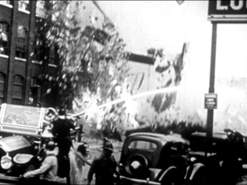 1947 shaky wide shot burning building collapsing on street/ dearborn, michigan - dearborn michigan stock videos and b-roll footage