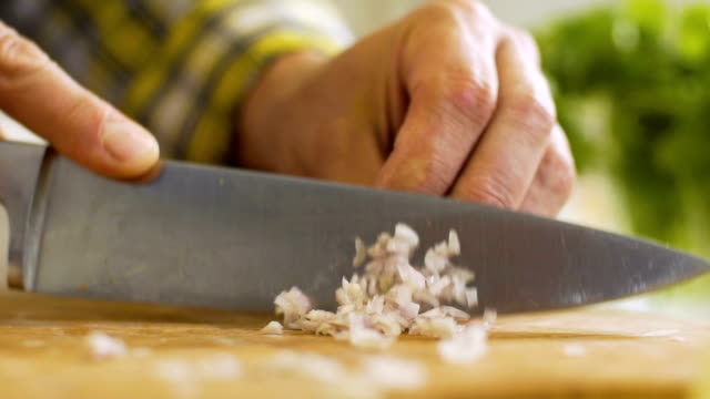 shallot finely chopped kitchen knife, slo mo - chopped food stock videos and b-roll footage