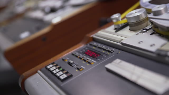 Shallow DOF shot of the digital display and controls of a 'Struder' reel to reel film