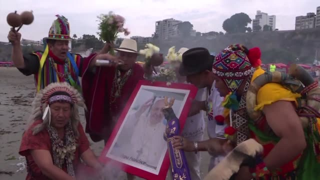 Shamans perform a ritual to welcome and protect Pope Francis during his visit to Peru one day before the pontiff's arrival at a beach in Lima on...