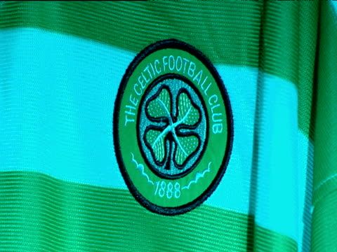 shamrock of celtic badge on football strip, celtic football club, celtic park, parkhead, glasgow - football strip stock videos & royalty-free footage