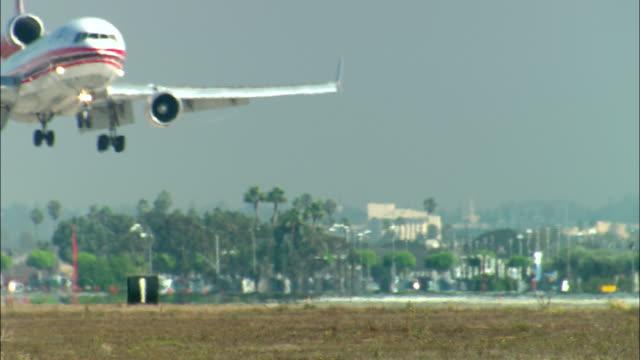 MS, Shanghai Airlines jumbo cargo plane landing on runway, Los Angeles, California, USA