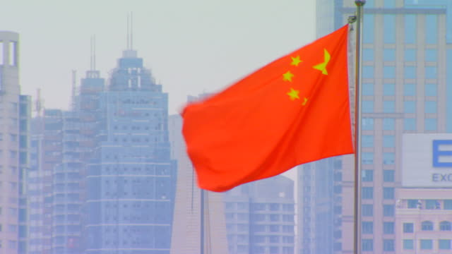 shanghai, chinachinese flag, city background - chinese flag stock videos & royalty-free footage