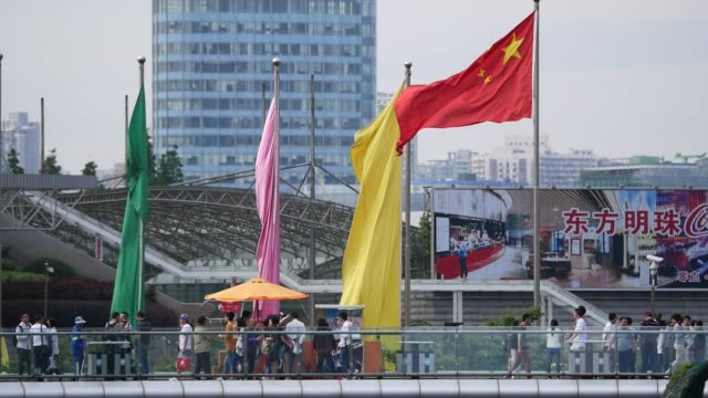 shanghai city in holiday colorful flag beside the china national flag - chinese flag stock videos & royalty-free footage