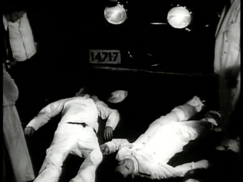 shanghai city lights vs two dead japanese sailors on floor day ws japanese navy ships vs japanese admiral talking to reporters ws chinese government... - 1937 stock videos and b-roll footage