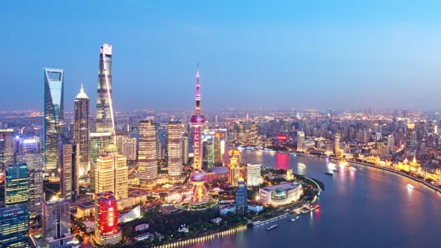 4k: shanghai cityscape at sunset to night time lapse, china - shanghai stock videos & royalty-free footage