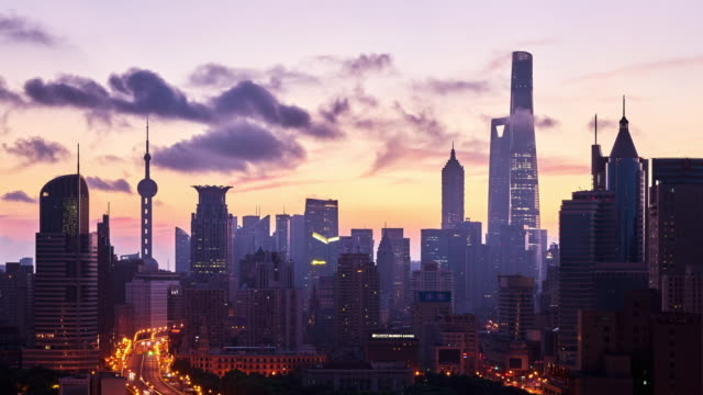 4k: shanghai cityscape view at dawn to day time lapse, china - dawn to day stock videos & royalty-free footage