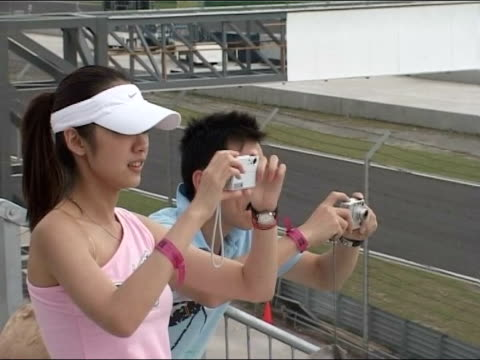 shanghai first chinese grand prix showing cars racing on track and spectators tx 11204 shanghai ms f1 boss bernie ecclestone along with chinese... - bernie ecclestone stock videos & royalty-free footage