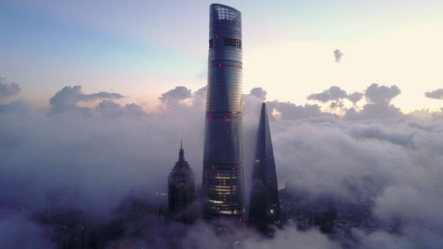 shanghai financial district in fog - china east asia stock videos & royalty-free footage