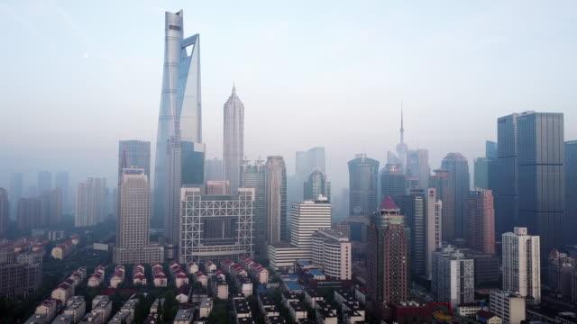 shanghai financial district in fog - shanghai tower stock videos & royalty-free footage