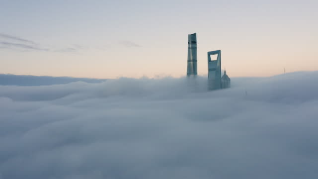 shanghai financial district in fog - the bund stock videos & royalty-free footage