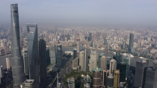 shanghai financial district in fog - shanghai world financial center stock videos & royalty-free footage