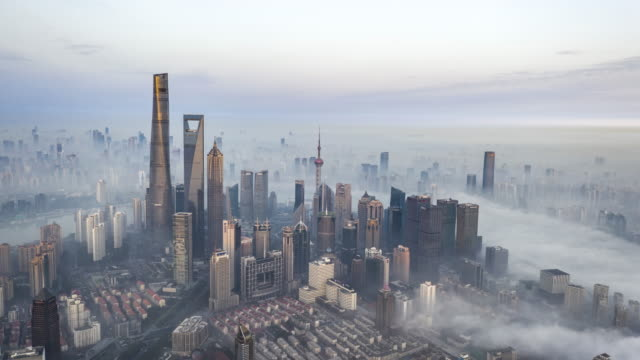 shanghai financial district in fog - drone point of view stock videos & royalty-free footage