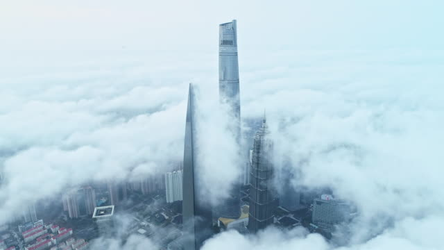 shanghai in clouds - downtown district stock videos & royalty-free footage