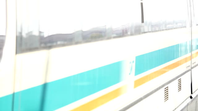 shanghai maglev train leave the station - train vehicle stock-videos und b-roll-filmmaterial