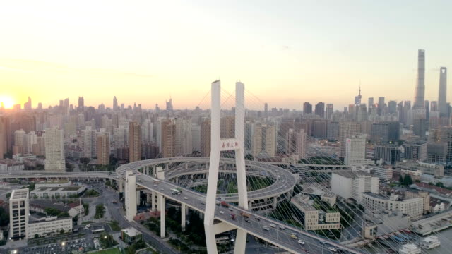 shanghai nanpu bridge and skyline sunset drone point of view - shanghai world financial center stock videos & royalty-free footage