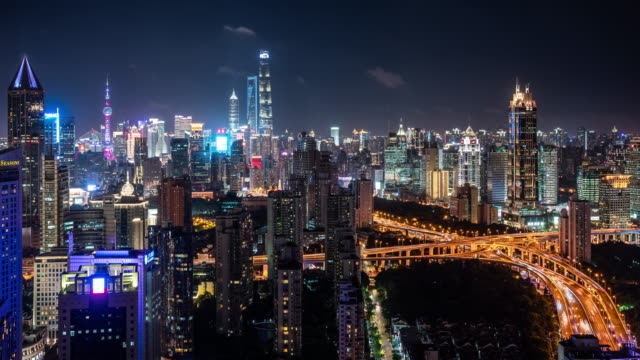 t/l ws ha shanghai skyline and busy traffic at night / shanghai, china - shanghai stock videos & royalty-free footage