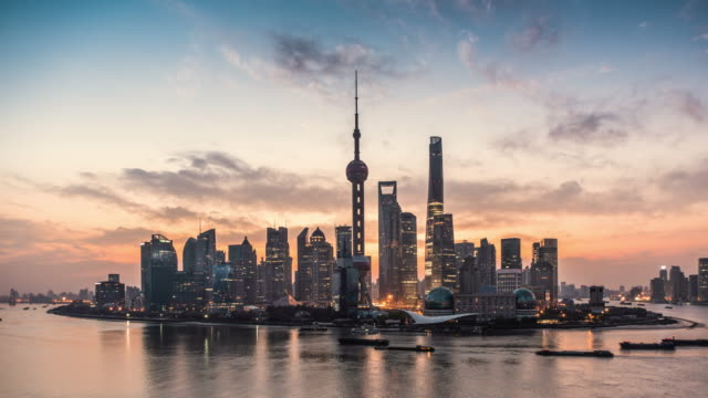 shanghai skyline and huangpu river at sunrise, showing pudong - skyline stock videos & royalty-free footage