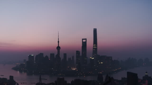 t/l shanghai skyline at dawn, from night to day / shanghai, china - dawn to day stock videos & royalty-free footage