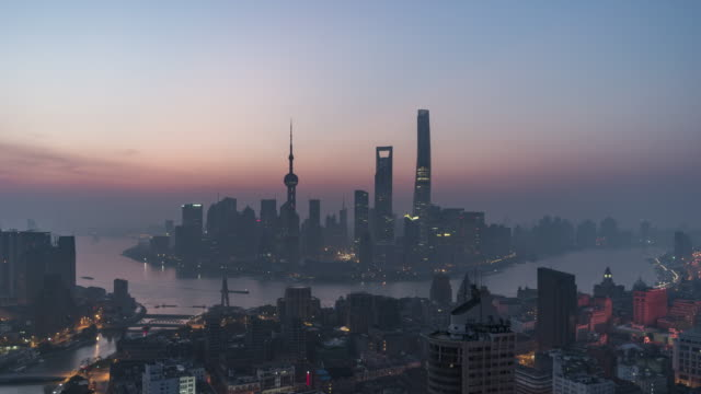t/l ws ha zi shanghai skyline at dawn, night to day transition / shanghai, china - dawn to day stock videos & royalty-free footage