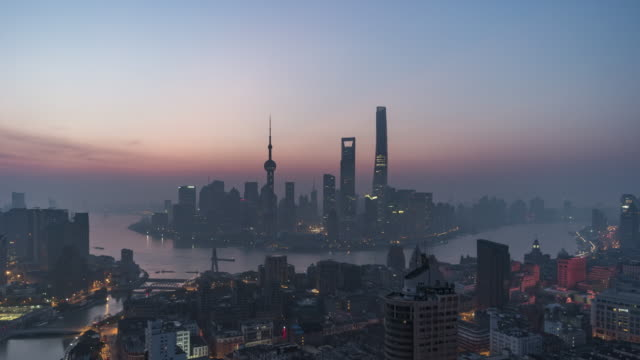 t/l ws ha shanghai skyline at dawn, night to day transition / shanghai, china - dawn to day stock videos & royalty-free footage