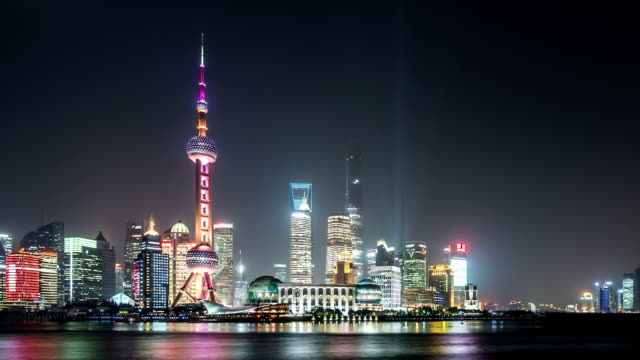 t/l ws zo shanghai skyline at night / shanghai, china - jin mao tower stock videos & royalty-free footage