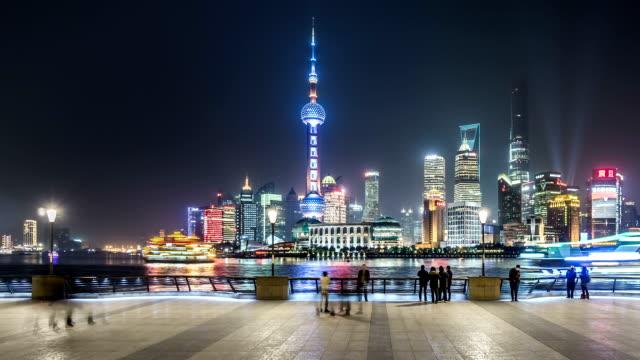 t/l ws pan shanghai skyline at night / shanghai, china - jin mao tower stock videos & royalty-free footage