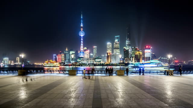 t/l ws shanghai skyline at night / shanghai, china - jin mao tower stock videos & royalty-free footage