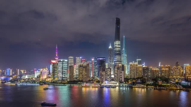 t/l ws ha shanghai skyline at night / shanghai, china - jin mao tower stock videos & royalty-free footage