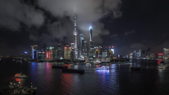 shanghai skyline at night - river huangpu stock videos & royalty-free footage