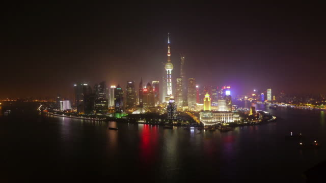 shanghai skyline at night  zoom in timelapse, pudong, huangpu river, oriental pearl tower, jin mao tower, shanghai international finance centre, shanghai world financial center, night, skyline, city lights, shanghai, china - jin mao tower stock videos & royalty-free footage