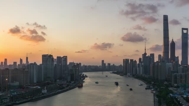 t/l ha pan shanghai skyline at sunset / shanghai,china - river huangpu stock videos & royalty-free footage